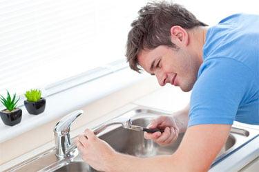 Plumber fix a tap